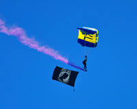 Navy SEAL Paratroopers fly the POW-MIA Flag
